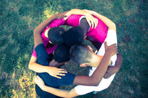 boys in a prayer circle