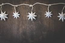 star lights on wood