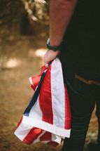Carrying a folded American flag.