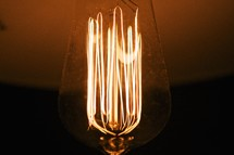 Incandescent light bulb with glowing filament