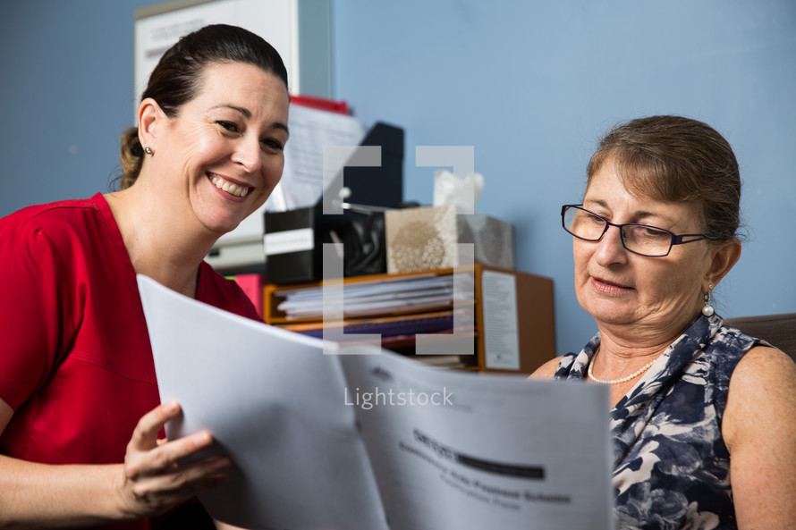 a healthcare professional reviewing insurance options