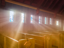 rays of sunlight shining through stained glass windows