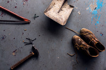 old tools and leather boots