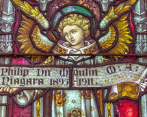 angel stained glass window memorial to Philip Du Moulin