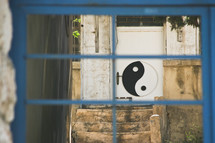 yin yang sign painted on a door