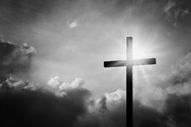 sunburst behind a cross
