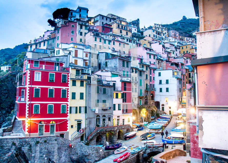 colorful houses and building on the side of a mountain in Italy