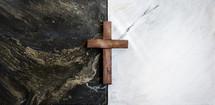 wooden cross on black and white tiles