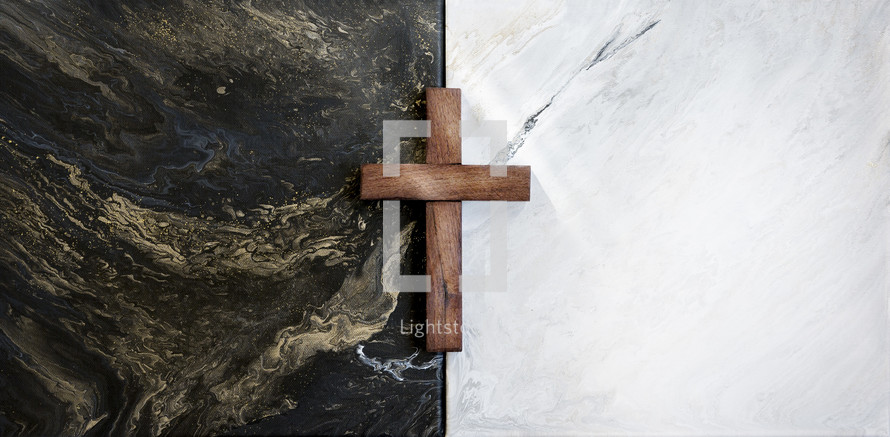 wooden cross on black and white tiles