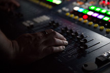 man at a soundboard