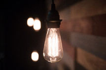 glowing hanging lightbulbs on stage