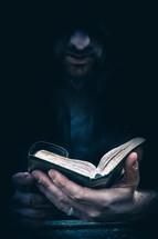 a man holding a small pocket Bible