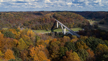 fall foliage and bridge