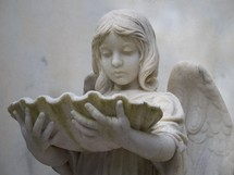 The Angel and the Oyster Shell - A historic statue of a female angel holding an oyster shell reminding us that this life is not the end but there is a place called Heaven.