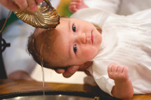 a baby being baptized
