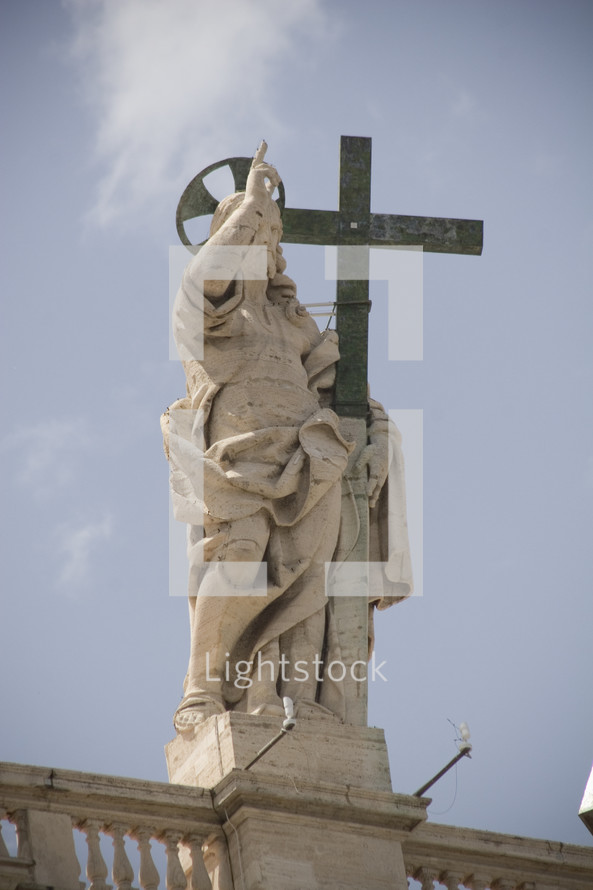 statue of Jesus holding a cross