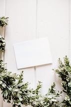 white envelope with boxwood border