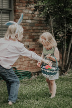 brother and sister on an Easter egg hunt