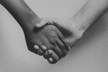close-up of holding hands against a white background