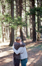 a couple hugging in the woods