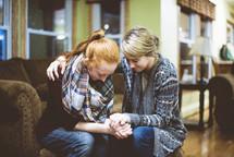 two women praying together