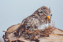 a bird figurine made of straw