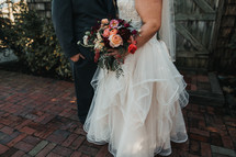 bride with her bouquet and groom