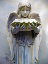 This statue of an angelic girl with wings is in a historic cemetery in the southern United States.