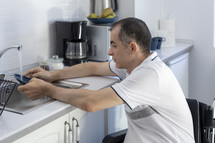 a man in a wheelchair in his kitchen
