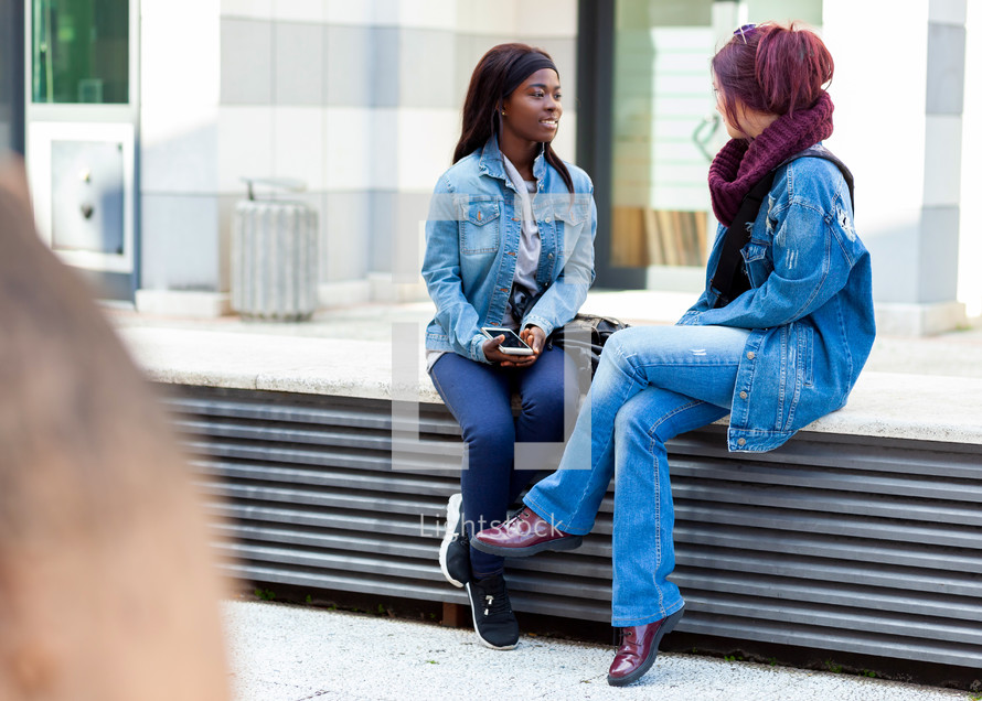 two girls talking together