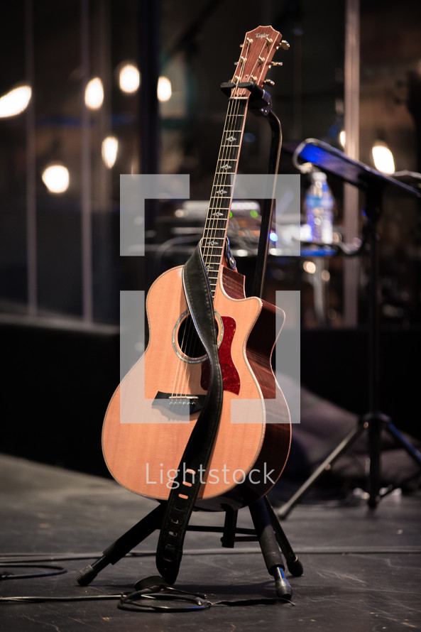acoustic guitar on a stage