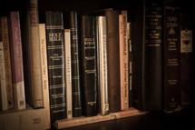 many Bibles on a bookshelf