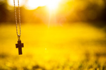 a cross necklace in sunlight