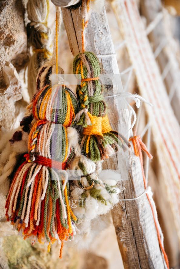 hanging tassels of yarn