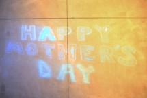 Mother's Day message in chalk on a driveway.