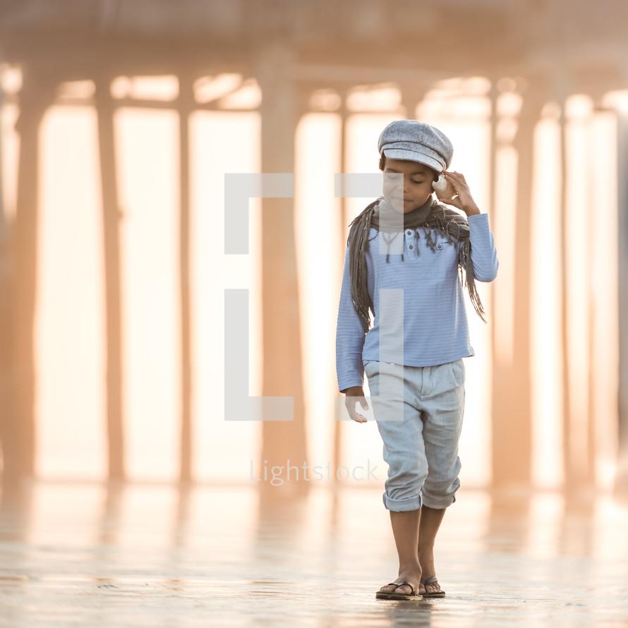 a boy looking for seashells on a beach