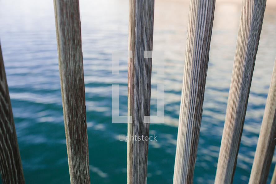 water through wood railings