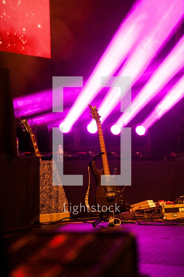 stage lights and an electric guitar