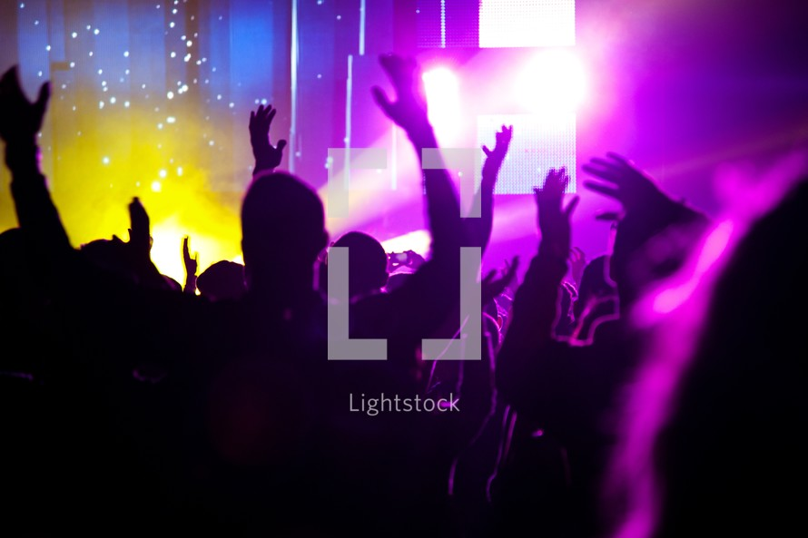 stage lights on silhouettes of audience members