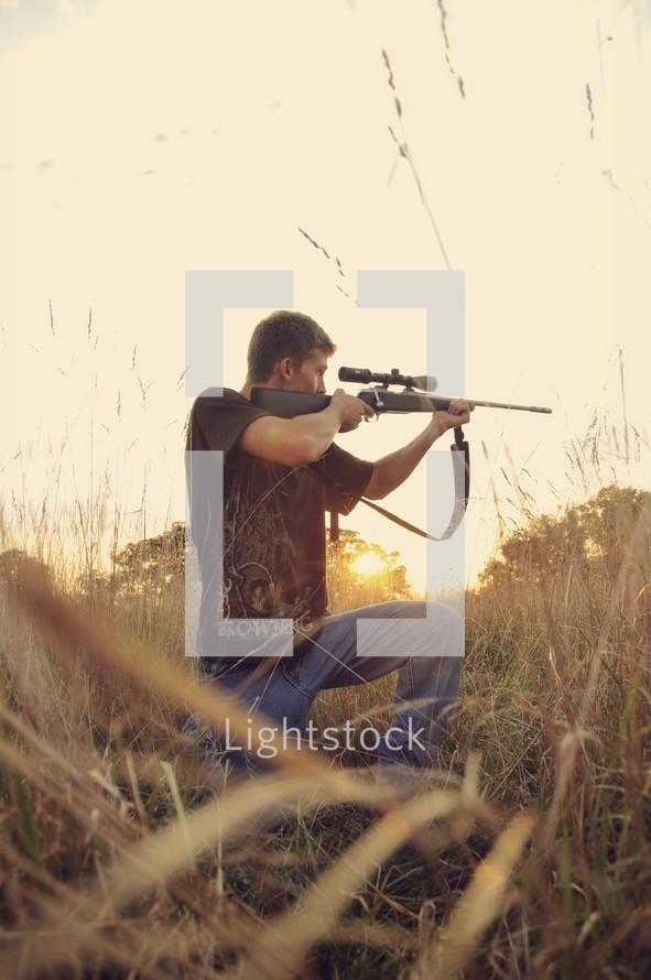 A man aiming a rifle.