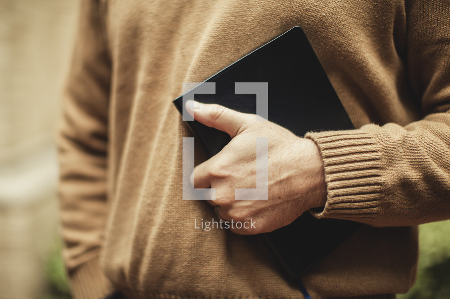 Man clutching BIble