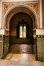 tile work on an arched doorway in Spain