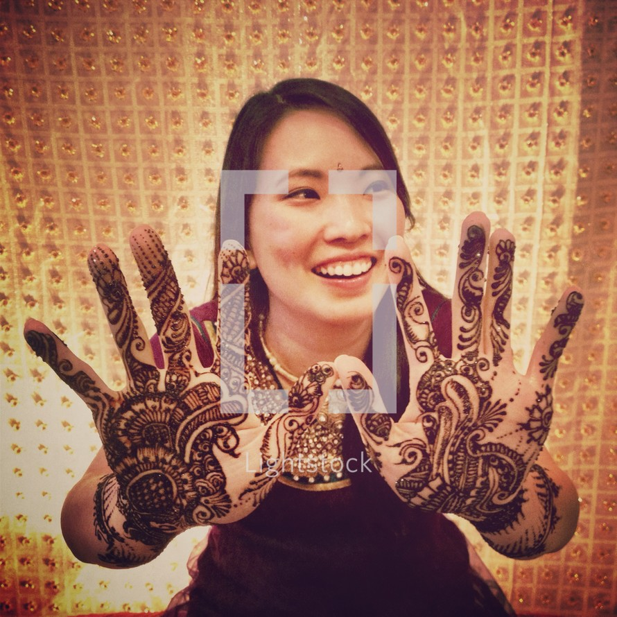 henna tattoos on a woman's hands