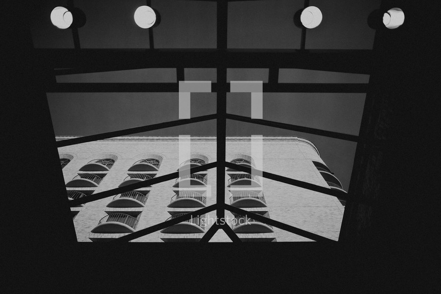 A view of a building through a skylight