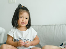 toddler girl sitting on a couch