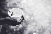 hand holding a cup of water