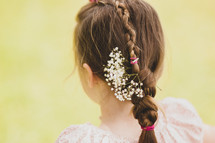 flowers braided into a girls hair