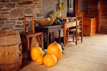 pumpkins in an old farm house