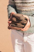 child holding rocks