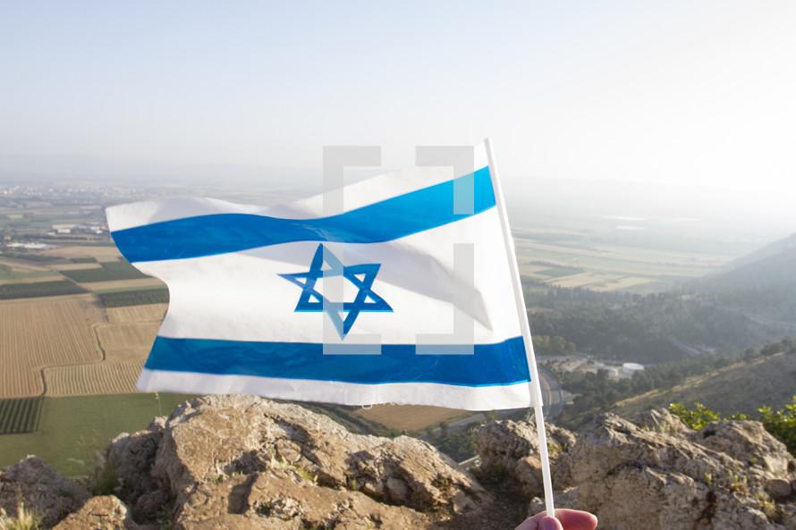 waving the Israeli flag